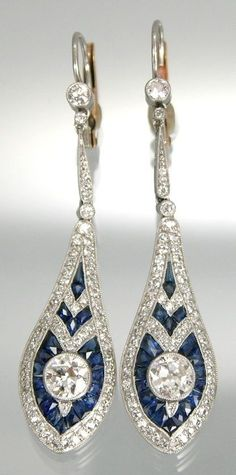 A Pair of Art Deco Sapphire and Diamond Ear Pendants. Mounted in platinum, sapphires, diamonds, and 18k yellow backs. Length 2 inches. #ArtDeco #earrings