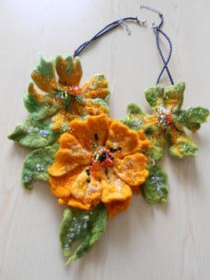 Beautiful process of creation.....Made to Order Felted Flower Necklace Green Orange and by MaijaFeja, $100.00