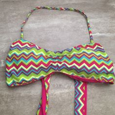 Victoria's Secret reversible top Excellent condition. Reversible. Patterned on one side and pink on the other. Ties in the back for better sizing. Comes with removable halter string. Victoria's Secret Swim Bikinis