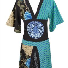 "Desigual ""Minakae"" kimono dress - size M Desigual ""minikae"" kimono dress - mixed prints on the dress - blue and green zigzags, other side is black with blue & white chrysanthemums - wide black obi-belt along the waist - v neck - asymmetric hem line - worn but in amazing condition! Desigual Dresses Midi"
