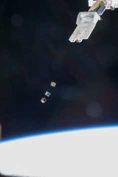 Cubesats Released From Space Station ISS038-E-003872 (19 Nov. 2013) --- Three nanosatellites, known as Cubesats, are deployed from a Small Satellite Orbital Deployer (SSOD) attached to the Kibo laboratory's robotic arm at 7:10 a.m. (EST) on Nov. 19, 2013. Japan Aerospace Exploration Agency astronaut Koichi Wakata, Expedition 38 flight engineer, monitored the satellite deployment while operating the Japanese robotic arm from inside Kibo. The Cubesats were delivered to the International Space…