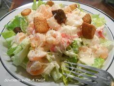 http://lynn-southernwithatwist.blogspot.com/2014/01/seafood-caesar-salad.html