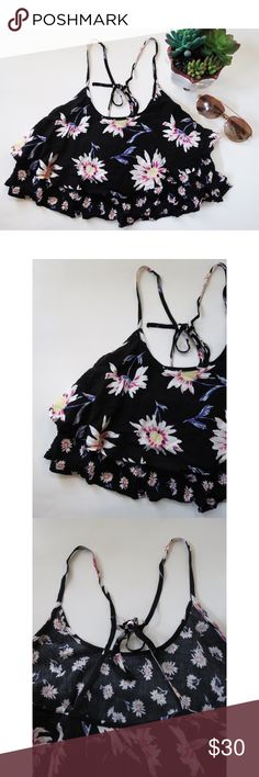 Urban Outfitters floral flounce crop top Beautiful floral flounce crop top from Urban Outfitters Kimchi blue. This top is a stunning statement piece, great for anyone's closet! Beautiful floral pattern, criss cross back, flounce style, and the perfect cropped fit! Get ready for summer with this top. Size small, in new like condition. Urban Outfitters Tops Crop Tops