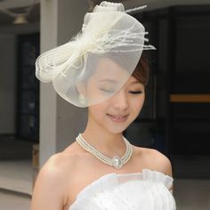 Alluring Design Tulle With Feather Wedding Headpiece