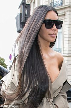 Radiant: Kim dazzled as she strolled in Paris