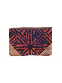 Batik Coral & Indigo Travel Bag by Della, a fashion line handcrafted by a community in Ghana, West Africa. The passionate, talented women who create the pieces are given an opportunity to build a foundation for a better life through jobs, education and skills training.