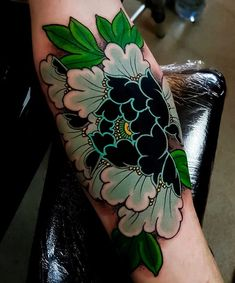 Japanese flower tattoo by @elliottjwells.#japaneseink #japanesetattoo #irezumi #tebori #colortattoo #colorfultattoo #cooltattoo #largetattoo #armtattoo #flowertattoo #peonytattoo #newschool #newschooltattoo #blackwork #blackink #blacktattoo #wavetattoo #naturetattoo | Artist: @japanese.ink