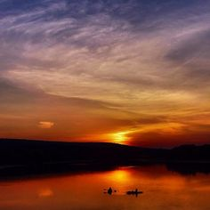 """Kayakers paddling out on Lake Nockamixon at sunset, captured by Instagram user @gregory_allen_kear during the 2014 """"Capture Your #BucksCountyMoment Photo + Video Challenge."""""""