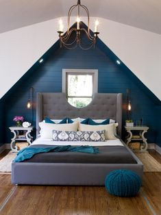 As seen on HGTV's Elbow Room, Chip Wade and his team used the pitch of the bedroom to add a unique elements to the Van Hattums' master suite. Their elegant bedroom set and luxurious chandelier bring out the Van Hattums' love for old world charm, while their moveable bed lends itself to the modern conveniences that the Van Hattums enjoy.