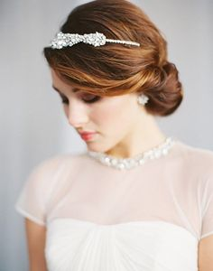 7. This side swept twist with simple bun is calling all brides with detailed necklines on their dresses. With simple, understated hair the details of your gown can really be seen and catch attention. See more of these Sea-inspired Wedding Ideas here captured by Megan Pomeroy Photography.
