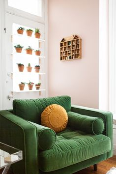 Nothing says statement like an oversized, green velvet armchair. There's plenty of room to relax!