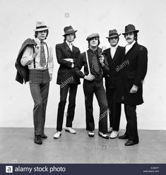 Download this stock image: The Moody Blues, dressed as gangsters for photoshoot, 18th October 1967. From Left to Right. John Lodge, 25, Bass. Justin Hayward, 21, Lead Guitar & Singer. Graham Edge, 25, Drums. Mike Pinder, 25, Melophone. Ray Thomas, 26, Flute. - EJND77 from Alamy's library of millions of high resolution stock photos, illustrations and vectors.