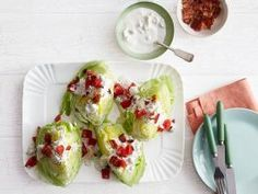 Lettuce Wedges with Blue Cheese Dressing : Trisha's easy wedge salad is perfect for a casual summer cookout. Core and quarter each head of lettuce and top with crumbled bacon, diced tomato and a generous dollop of homemade blue cheese dressing.