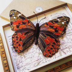 A new Painted Lady wall butterfly 28cm, the biggest I make at the moment. My wall pieces now come in these smart boxes lined with vintage maps. #entomology #entomologist #entomologyart #butterflies #butterfly #paintedlady #fauxtaxidermy #lepidoptera #lepidopterist #embroidery #embroideryart #silk #mycreativebiz #collection #handmade #handmadewithlove