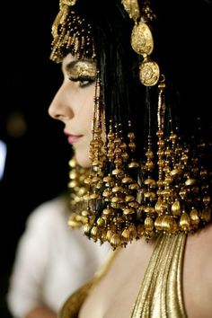 Avant Garde Hair. Medium Length. Gold Beaded Hair.