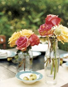 Table decorations - flowers in glass jars