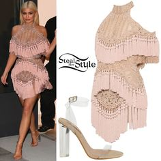 Kylie Jenner was spotted leaving her apartment in New York before the Harper's Bazaar Party wearing a Balmain Embellished Tulle Dress with Tassels ($24,913.00) with Yeezy Season 2 Transparent Sandals ($495.00). You can find similar sandals for less at Ego ($39.78).