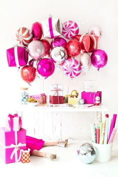 A Goodies + Gift Wrap Holiday Party (+ DIY Present Balloons!) | studiodiy.com