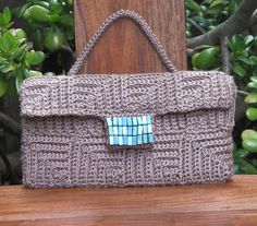 crocheted clutch - inspiration for me as I'm sure it's just mitered squares worked in back loop only for the texture.