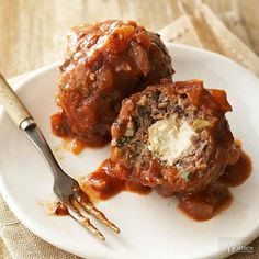 The secret to our stuffed slow cooker meatballs? Kasseri, a traditional salty, sharp cheese doused with Greek liqueur and lit on fire. Each of our lamb-and-beef meatballs has the classic cheese nestled inside./
