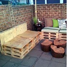 Patio Furniture Made From Pallets | threw a few pillows on from our lounge and used tree stumps that I ...