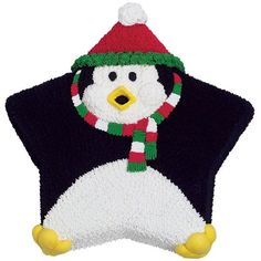 Fowl Weather Friend Cake - Holiday penguin takes the star cake pan in a new direction! Easy  techniques are all you need for this fun fellow. (Remember to start  with chocolate icing when making black so less icing color in needed.)