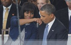 The First Couple show affection in the stands as they watch the parade.