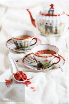 Two Japaense cups of green tea with dried Goji berries, Lycium barbarum
