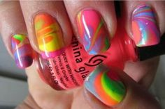 Swirly Tie-dyed nails  Apply a basecoat and let it dry. You can also add a coat of color to make the final design richer.  -Put vaseline on your fingers and cuticles, but not on your nails (It keeps the lacquer from sticking to your fingers  -Fill a shallow bowl with water and drip in the color combination you want  -Swirl the polish with a toothpick  -Dip fingertips in and soak for a min or two