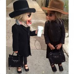 Monica Rose's daughter dressed up as the Olsen twins for Halloween // A hat, mini Balenciaga bag, oversized coat, sunglasses, a scarf, and a cup of Starbucks coffee perfects the look.