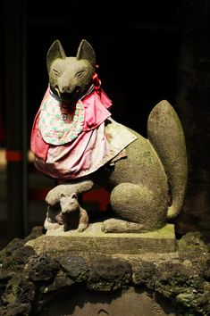 Inari Statue at Hanazono-Inari-Jinja, Ueno Park, Tokyo.  Inari 稲荷 is the Japanese Kami (God) of Fertility, Rice, Agriculture, Foxes, Industry and Success, and is one of the Most Important Kami in Shinto. Kitsune 狐 or きつね (Fox) are Believed to be the Special Messengers of Inari - Especially White Foxes .