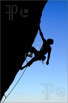 Picture of silhouette of rock climber climbing an overhanging cliff with blue sky background I think this is a way to purchase the rights to use the image Found at featurepics.com