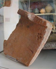 Roman roof tile with a cat's paw imprint from around 100 C.E. - Gloucester City Museum