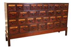 An old French-style apothecary cabinet. I wonder if I could ever dream to make something similar.
