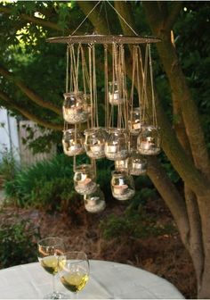 Baby Food Jars = outdoor chandelier. this is why I have been saving my jars!