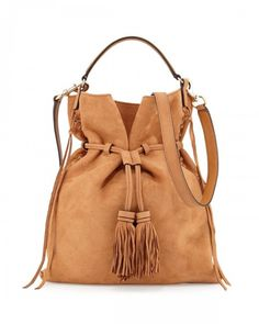 Shop moto drawstring crossbody bag almond brown from Rebecca Minkoff in our fashion directory.