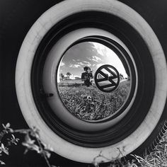 Vivian Maier – mirror self portraits. Wolksvagen hub cap.