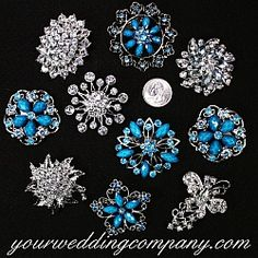 This lot of 10 blue and clear crystal brooches is perfect for creating a beautiful brooch bouquet, decorating wedding centerpieces or giving as bridesmaid gifts. www.yourweddingcompany.com
