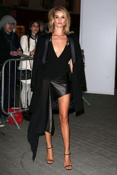 Rosie Huntington-Whiteley in an Anthony Vaccarello dress  The dress is a bit too sexy for my taste, but I love the oversized blazer over the shoulders