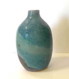 """Beautiful. Beautiful! Made by a fellow potter from the """"All Handmade by ME"""" team on Esty! Stoneware Pottery Vase Layered with Turquoise by caseymcpottery, $45.00"""