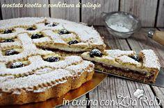 La crostata con confettura di ciliegie e ricotta è una crosta gustosissima e molto carina. Facile da preparare grazie anche alla pasta frolla utilizzata