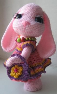 The Pretty Bunny Amigurumi Pattern will help you to create a crochet toy with a lot of cute details. This lovely amigurumi bunny is an ideal Easter gift!Pretty Bunny amigurumi in pink dress - Amigurumi TodayIf you are looking for a Bunny Crochet Free Patt Crochet Easter, Easter Crochet Patterns, Crochet Patterns Amigurumi, Cute Crochet, Crochet Crafts, Crochet Dolls, Crochet Baby, Crochet Projects, Diy Crafts