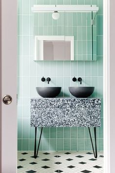 Pin legs on a sink unit with concrete bowls. Love the mint wall tiles and black and white floor. Dream bathroom!