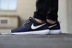Check out the latest colorway of Nike s Roshe NM Breeze sneaker. The midtop  runner sports a violet layer underneath black mesh caging. 513de7960