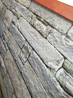 Pellicola stampata con immagine di muro in pietra applicata a bancone