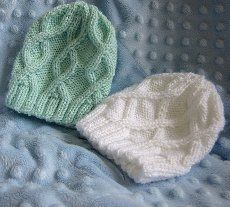 These knitted baby hats are absolutely adorable.  Make these Cabled Baby Hats in two distinct styles: one with a simple cable pattern and the other with cabling across the entire hat.  Heather recommends that you have experience in both knitting in the round and cable knitting before tackling version two of this hat.