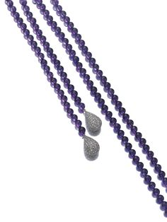 Amethyst and diamond longchain, Michele della Valle Designed as a line of amethyst beads, terminating at either end with a drop pavé-set with rose diamonds, length approximately 1645mm, signed MdV.