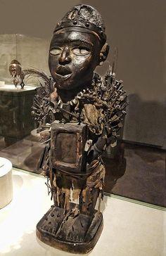 Power Figure (Nkisi Nkondi) Vili-Kongo Republic of Congo Early-mid 19thcentury CE Wood metal glass fabric fiber cowrie shells bone leather gourds and feather