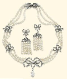 AN ANTIQUE PEARL AND DIAMOND SUITE. Christie's. Love the bows!