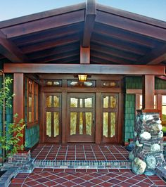 San Francisco Craftsman. Designed by Tim Ward, principal of Ward-Young Architects, and Associate Mike Mussano, this home situated in the Lafayette Hills of the East Bay of San Francisco, is perhaps one of the finest examples of Greene & Greene craftsman style architecture in northern California.The exterior finishes are attended to as well with large covered heavy timber proches, shingle walls with stone and brick wainscot and an imported tile roof.